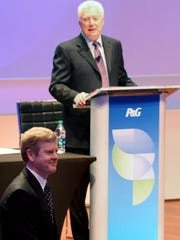 Incoming CEO David Taylor (left) looks at the audience