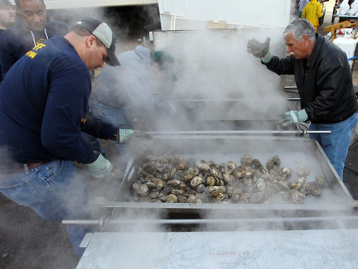 Batches of steamed oysters come out at the St. George