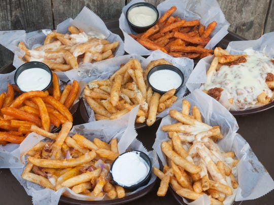 A sampling of the french fries at The Chicken or the Egg restaurant in Beach Haven (clockwise from top left): disco fries, sweet potato fries, sloppy fries, crabby cheese fries, loaded fries, Buffalo fries, and garlic pub fries (center) .