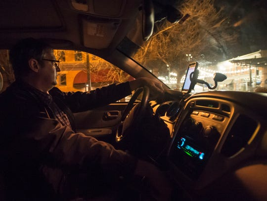 Uber and Lyft driver Scott Saathoff waits for passengers
