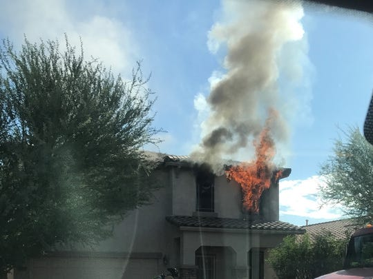 A house fire in the city of Maricopa displaced 13 residents Tuesday, fire officials said.