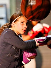 Adriana Dorm, 11, of York City, works the bag at Stick-N-Move