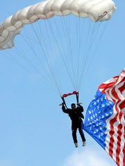 Professional skydiving team Team Fastrax will give three patriotic skydiving demonstrations this weekend, including a skydiver with a 2,000-square-foot American flag.