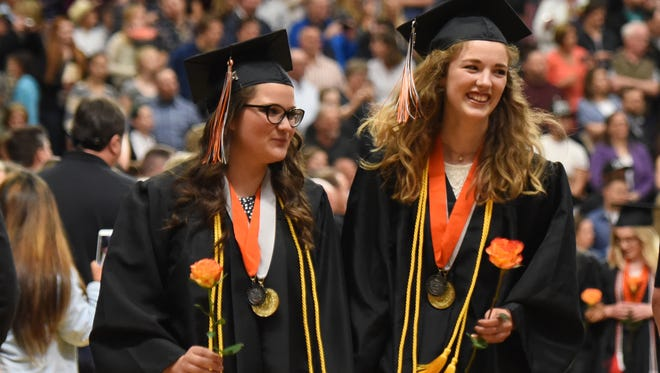 Graduates make their entrance during the commencement ceremony on Thursday, June 8, 2017, at Silverton High School.