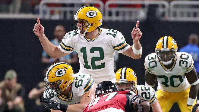 Green Bay Packers quarterback Aaron Rodgers (12) signals at the line against the Atlanta Falcons Sunday, September 17, 2017 at Mercedes-Benz Stadium in Atlanta, Ga.