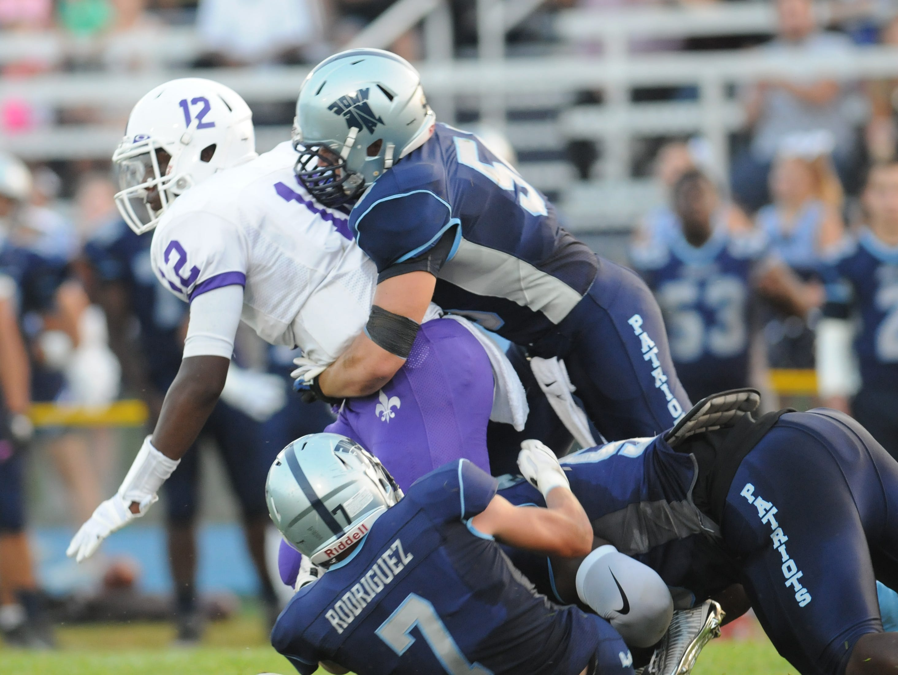 John Jay's CJ D'Andrea brings down New Rochelle's Greg Powell during Friday's home game.