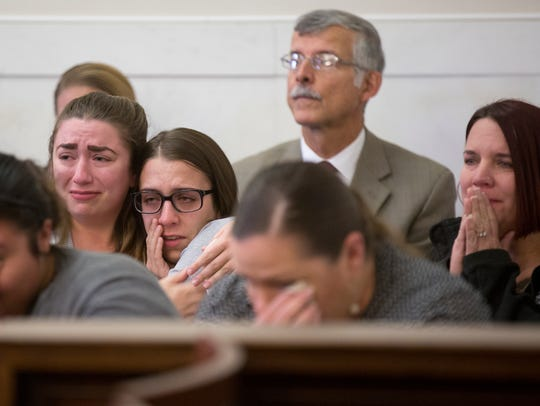 Jessyka Prather, 26, left, and Cyerra Prather, 22, react to the sentencing of Earl Jones, 24. Cyerra was the ex-girlfriend of Jones.