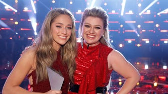 "Brynn Cartelli, left, winner of Season 14 of ""The Voice,"" shares her victory  with her coach, Kelly Clarkson."