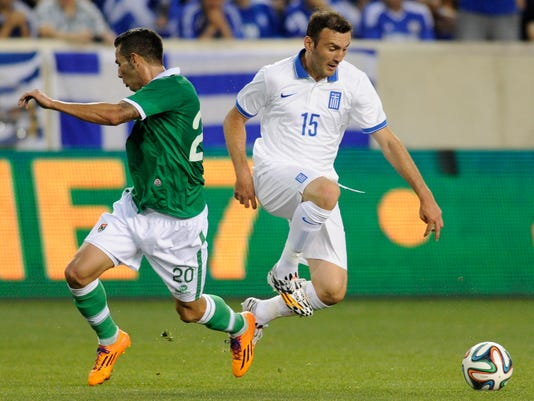 Greece's Vasileios Torosidis, right, goes for the ball by Bolivia's Alejandro Melean Villaroel during the first half of an international friendly soccer match Friday, June 6, 2014, in Harrison, N.J.. (AP Photo/Bill Kostroun)