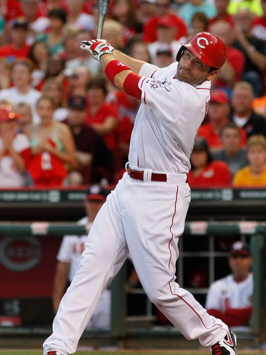 Cincinnati Reds' Joey Votto hits a one run double against the Milwaukee Brewers in the fifth inning of their baseball game in Cincinnati, Friday July 4, 2014. (AP Photo/Tom Uhlman)