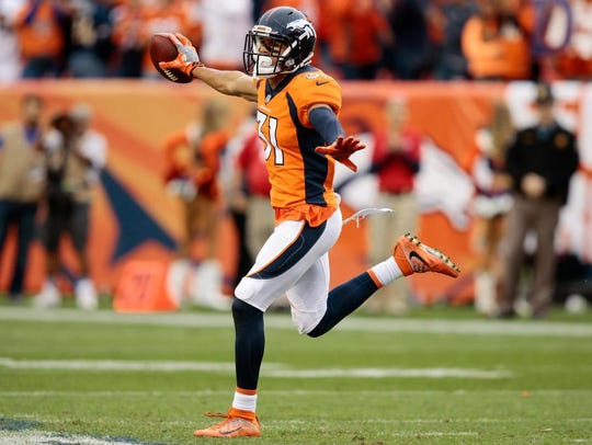 Denver Broncos strong safety Justin Simmons (31) celebrates after a play in the fourth quarter against the Oakland Raiders on Oct. 1, 2017, at Sports Authority Field at Mile High.