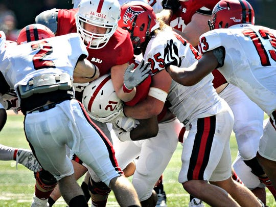 Tackle Andrew Jarosz blocks  during Saturday's game at Clemens Stadium in Collegeville.