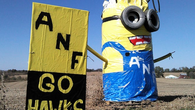 With pickup tires for goggles, this giant Minion in bib overalls supports farmers and Hawkeye football from its perch along Highway 1 north of Solon, the handiwork of the Thuerauf farm family.
