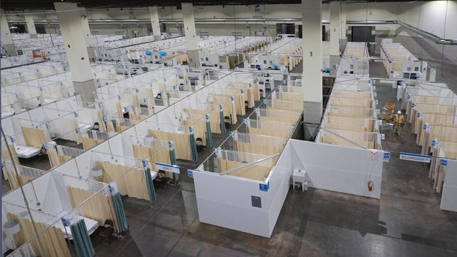 With officials aiming to keep surging COVID-19 cases from overwhelming the state's hospitals, workers set up a temporary hospital inside the Rhode Island Convention Center in April. The hospital has not been used but remains available in case of a future COVID-19 surge, according to the state Department of Health.