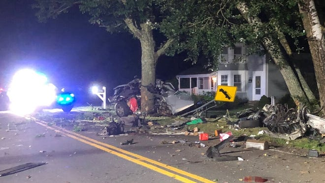 Debris litters the road where a speeding car struck a tree on Old Main Street near River Street in South Yarmouth late Thursday night. The driver was declared dead at the scene.