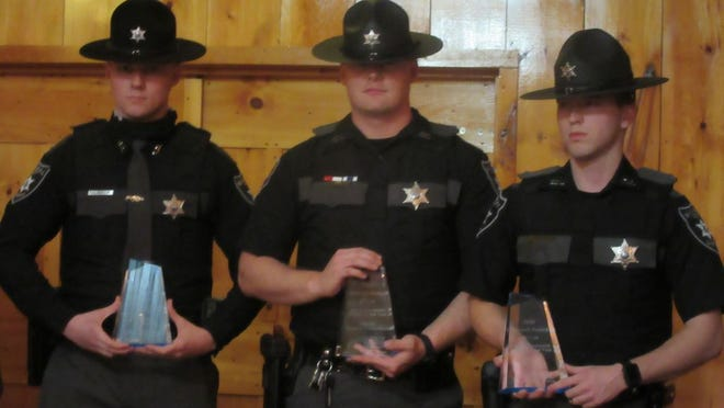 Mineral County Sheriff's Deputies Ryan Morgan, Jonathan Hotchkiss and Tyler Biggs were recognized as Law Enforcement Officers of the Year during the Mineral County Chamber of Commerce Summit Awards Wednesday.  Tribune photo by Ronda Wertman