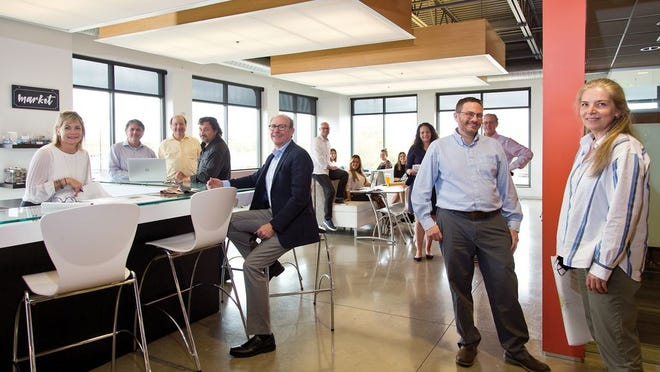 The M+A Architects team, with President Mark Daniels seated, in glasses and suit jacket, center.