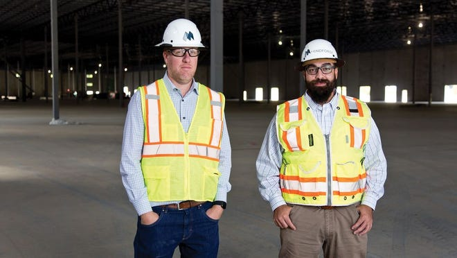 MindForge founders Stokes McIntyre and Shahin Aftabizadeh onsite at a Pepper Construction job.