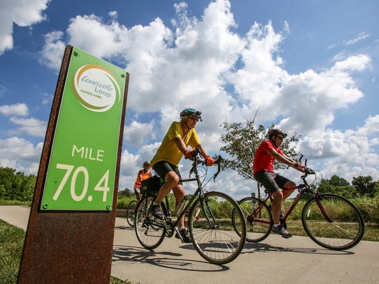 Cyclists ride around the Parklands of Floyds Fork,