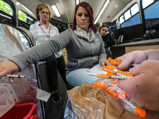 Amber Carmack watches as an intravenous drug user drops