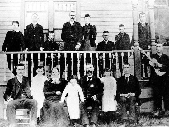 Solanus Casey, seated in the top row third from left, posed for a portrait on Aug. 14, 1892 in Superior, Wisconsin, with his siblings and parents.