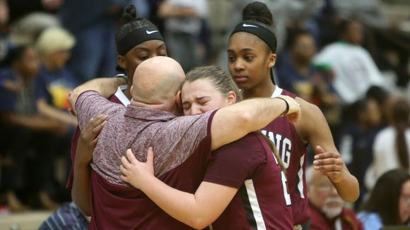 Ossining coach Dan Ricci consoles Kailah Harris, Aubrey Griffin and Kelsey Quain after the Pride lost to Baldwin 87-60 in the girls Class AA state championship game at Hudson Valley Community College in Troy March 18, 2018.