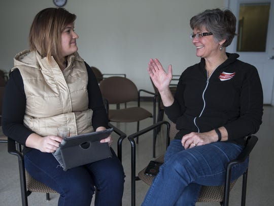 Amy Haneline (left), talks beer with Anita Johnson, who runs Great Fermentations.