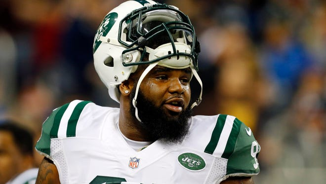 In this Nov. 24, 2014, photo, New York Jets defensive end Sheldon Richardson watches during warmups before an NFL football game against the Buffalo Bills in Detroit. Richardson felt helpless as he watched the scenes near his hometown unfold on TV and social media. He was born and raised in St. Louis, just a few minutes away from the suburb of Ferguson, Mo., where police officer Darren Wilson was not indicted by a grand jury last week in the shooting death of Michael Brown.