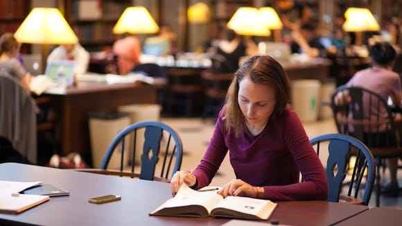 "Demidova, a financial economics major, studies in Columbia's Butler Library. Along with the physical toll of food insecurity, she says, there's an academic toll. ""The reality is that you can't focus on anything because you're hungry. You have to read through the same sentence three times because your stomach is growling."""