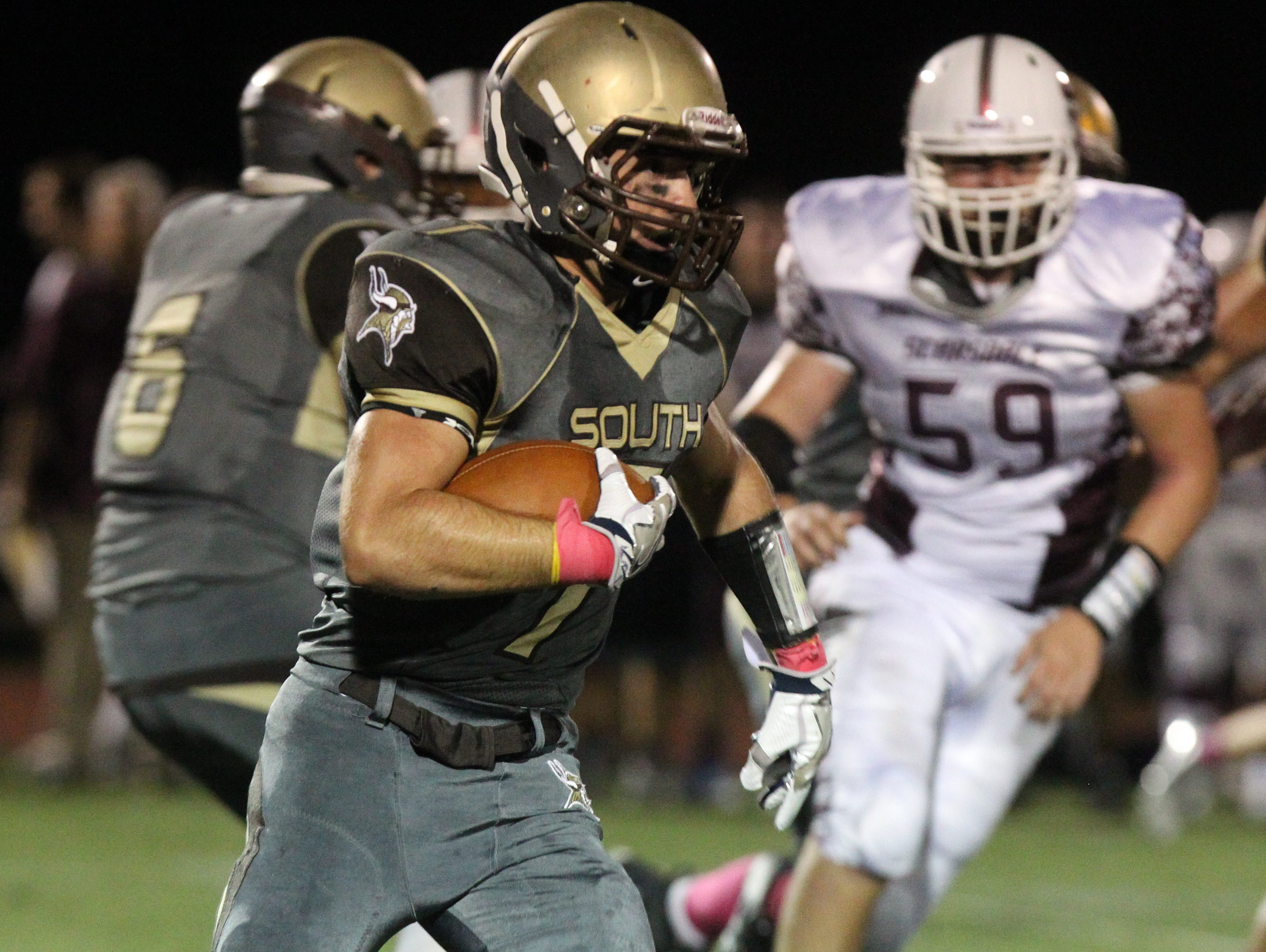 Clarkstown South's Sam Mistretta is pursued by Scarsdale's Dylan Quirk during their game at Clarkstown South Oct. 7, 2016.