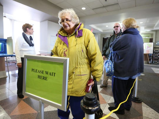 Voters wait in line at Two Rivers City Hall April 5,