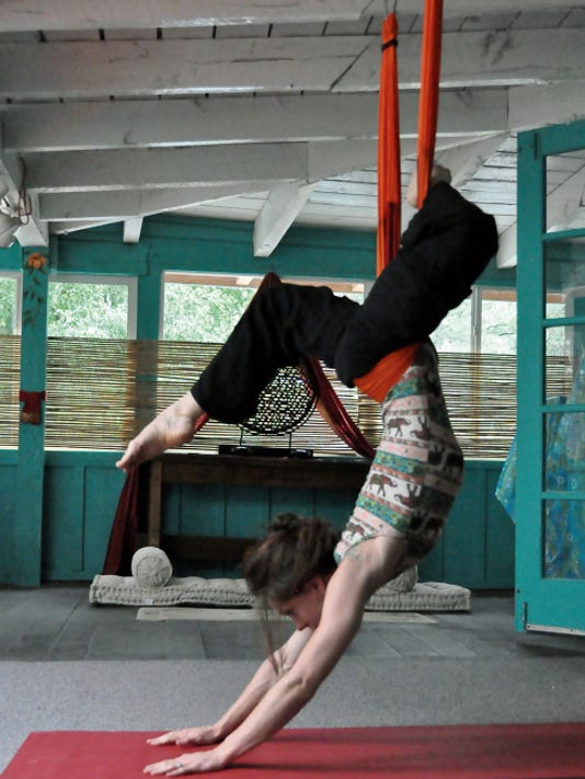 Silk aerialist Ashley Hall offers a new twist on traditional yoga.