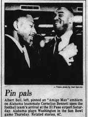Five-time NFL Pro Bowler Cornelius Bennett, right, receives an Amigo Man lapel pin from his Alabama teammate, Albert Bell, upon their arrival at El Paso International Airport. Alabama played Washington in the 1986 Sun Bowl.