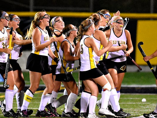 Red Lion celebrates a 2-1 win over New Oxford in girls field hockey action at Horn Field in Red Lion, Pa. on Thursday, Oct. 15, 2015. Dawn J. Sagert - dsagert@yorkdispatch.com