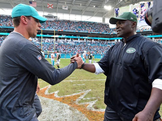 Miami Dolphins head coach Adam Gase (L) shakes hands with New York Jets head coach Todd Bowles (R) after the Miami Dolphins defeat the New York Jets at Hard Rock Stadium. (Jasen Vinlove-USA TODAY Sports)