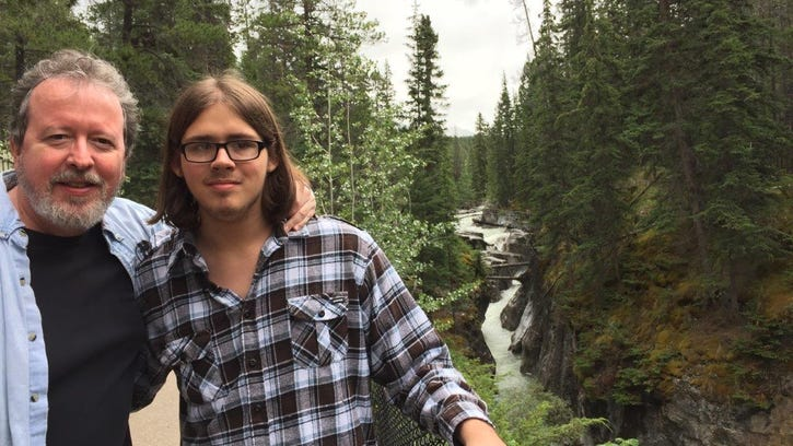 """Columnist Mark Hinson and his nephew, Hub """"Cub"""" Chason, visit a waterfall in Jasper National Park in July."""