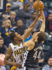Bojan Bogdanovic (44) shoots the ball while Indiana