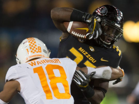Tennessee defensive back Nigel Warrior (18) attempts to take Missouri running back Larry Rountree III (33) down during a game between Tennessee and Missouri at Faurot Field in Columbia, Missouri, on Saturday November 11, 2017.
