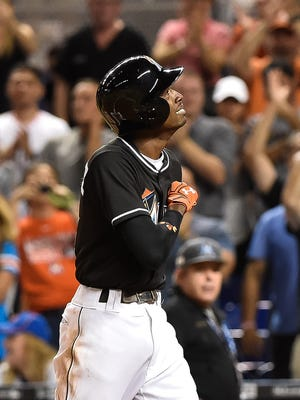 Dee Gordon reacts after hitting a solo home run in  the first inning.