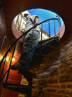 Blue Mounds State Park Manager Chris Ingebretsen descends the spiral stairway in the Frederick Manfred house in the park near Luverne July 22. The house was owned by noted novelist Frederick Manfred but is now used as an interpretive center at the park.