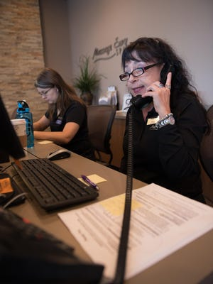 Massage Envy Junior Manager Sheila Trumble of Victor, right, and Sales Associate Clarissa Hamm of Lyons, make calls to client confirming their appointments.
