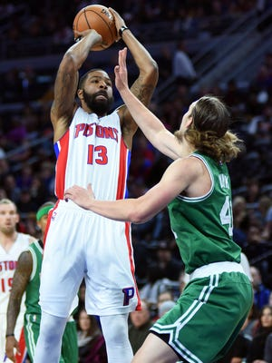 Pistons forward Marcus Morris (13) shoots as Celtics center Kelly Olynyk (41) defends during the second quarter Saturday at the Palace.
