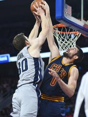 Cavaliers forward Kevin Love (0) blocks a shot by Pistons forward Jon Leuer (30) during the third quarter of the Pistons' 106-90 win Monday at the Palace.