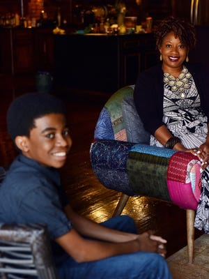 Jaden Nixon, 15, sits with his mother Dee Bookert Nixon at their home in Jackson. Jaden was diagnosed with Sickle Cell Disease right after birth.