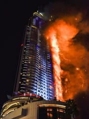 Flames consume The Address Downtown Hotel in Dubai in December 2015.