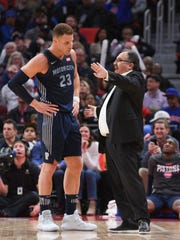 Pistons forward Blake Griffin talks to coach Stan Van Gundy during a game March 9.