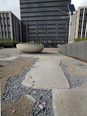 Pavement is crumbling on the plaza in front of the Indianapolis City-County Building, 200 E. Washington St., on April 15, 2014.