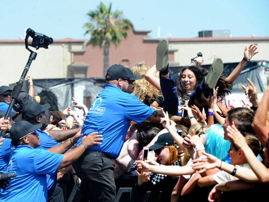 Fans crowd surf to music from Knuckle Puck on Sunday at the Ventura County Fairgrounds.