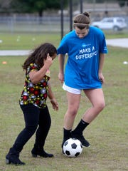 "Western Washington University soccer player Gabby Brower passes the ball to MacArthur Elementary School third grader Mylie Thornton on Wednesday as part of the NCAA Division II soccer outreach program. Soccer teams from all over the country, four men's teams and four women's teams, have arrived in Pensacola for the NCAA II Final Four hosted by the University of West Florida at Asthon Brosnaham Park. In addition to tournament play, the teams are visiting schools this week to get kids excited about soccer and stress the importance of studying in addition sports. ""Every time they have made it to the final four this is what they look forward to the most,"" said head coach Travis Connell."