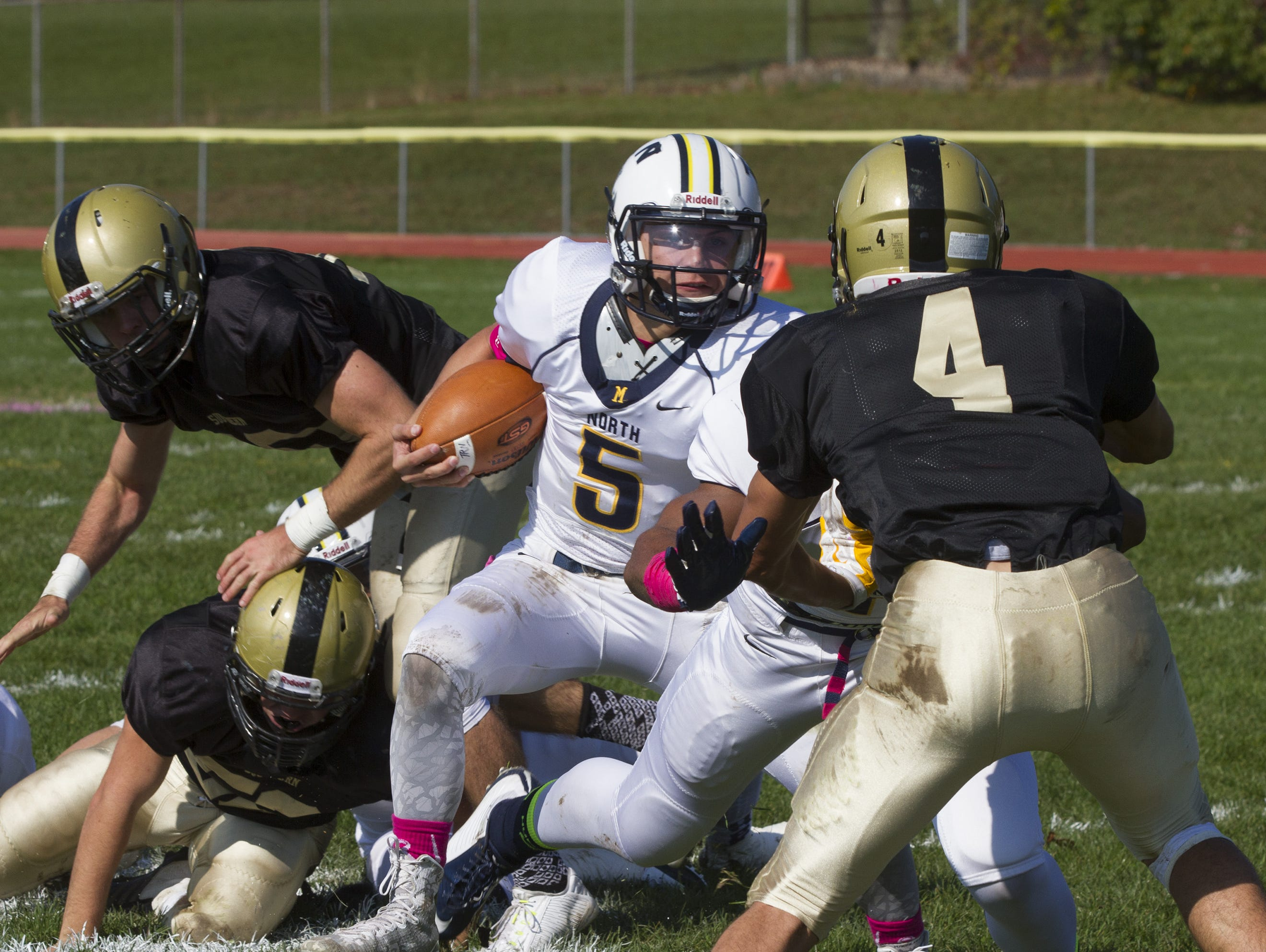 Toms River North quarterback Mike Husni shown running with the ball in 2014 against Southern, will be a key player for the Mariners in the NJSIAA South Group V championship game.